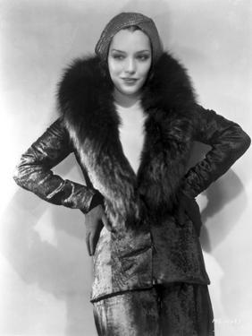 Lupe Velez smiling in Black Leather Jacket with Fur Collar by Movie Star News