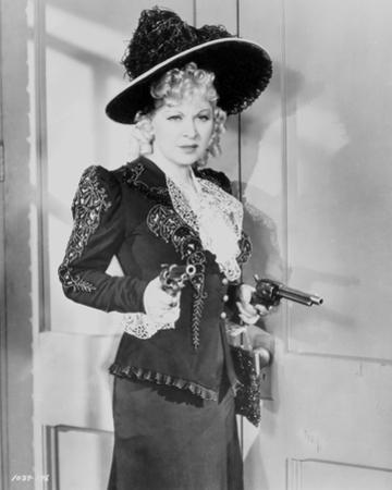 Mae West Holding Tow Pistols in Black and White Dress by Movie Star News