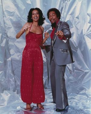 Marilyn McCoo standing in Dress With Man by Movie Star News