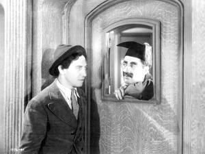Marx Brothers Scene of a Man Staring a Painting by Movie Star News