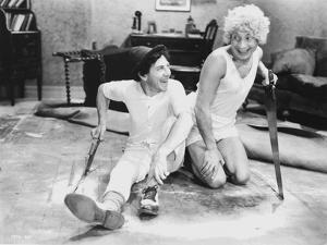 Marx Brothers sitting on the Floor wearing White Outfit by Movie Star News