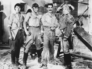 Marx Brothers standing with Construction Outfit with a Soldier- Photograph Print by Movie Star News