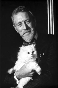 Max Von Sydow in Black With Cat by Movie Star News
