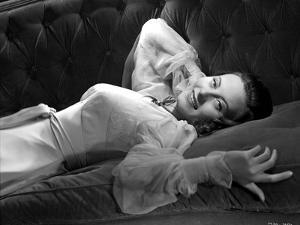 Michele Morgan Lying on a Couch by Movie Star News