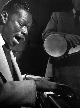 Nat Cole Playing Piano While singing by Movie Star News