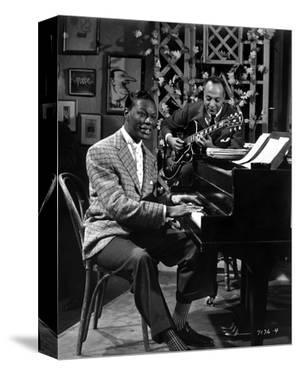 Nat Cole singing in Suit by Movie Star News