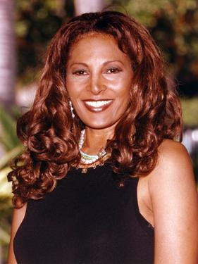 Pam Grier smiling in Black Dress Portrait by Movie Star News
