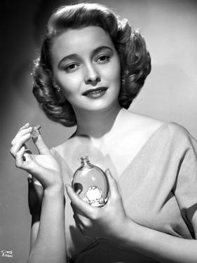 Patricia Neal Holding Perfume in Black and White by Movie Star News