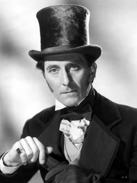 Peter Cushing Posed in Black Suit With Hat by Movie Star News