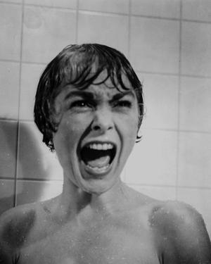 Psycho Close Up Portrait of Woman Screaming in Black and White by Movie Star News