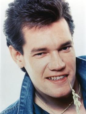 Randy Travis smiling in Close Up Portrait wearing Blue Denim Jacket by Movie Star News