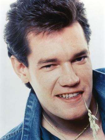 Randy Travis smiling in Close Up Portrait wearing Blue Denim Jacket by Movie Star News