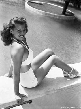 Rita Hayworth Seated on the Pool Side by Movie Star News