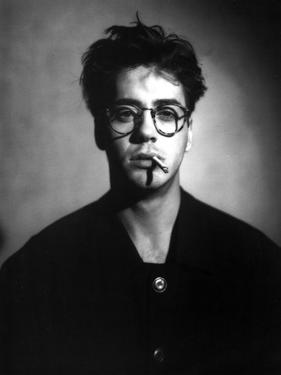 Robert Downey in Black Suit With Cigarette by Movie Star News