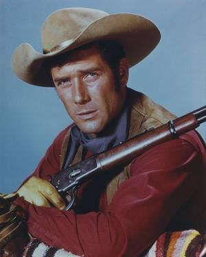 Robert Fuller in Cowboy Outfit with Rifle Portrait by Movie Star News