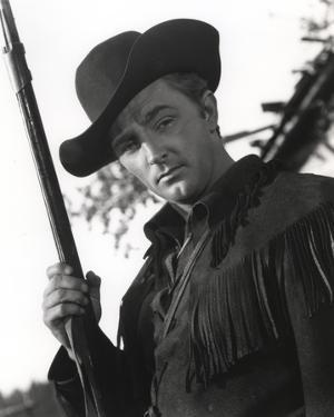 Robert Mitchum Holding a Rifle in a Western Outfit by Movie Star News