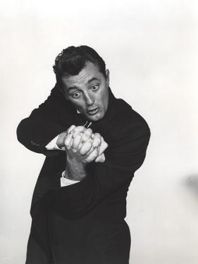 Robert Mitchum Posed in Black With Black and White Background by Movie Star News