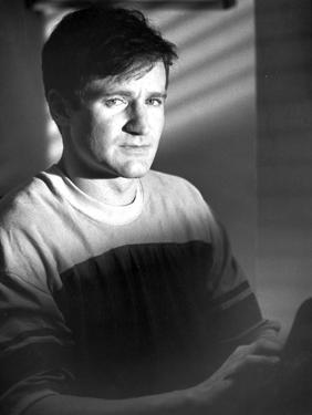 Robin Williams in sitting in White by Movie Star News