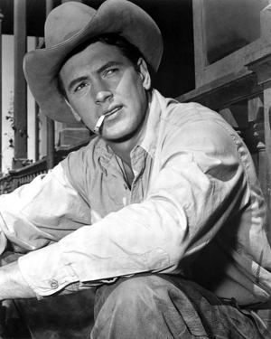 Rock Hudson Posed in Cowboy Outfit With Cigarette in Mouth by Movie Star News