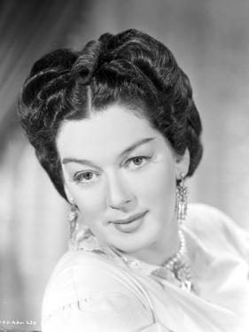 Rosalind Russell smiling with Victorian Hairstyle by Movie Star News