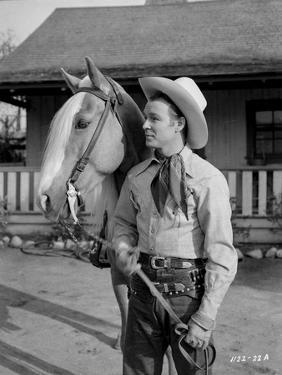 Roy Rogers Holding the Horse's Reins by Movie Star News
