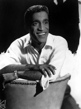 Sammy Davis smiling in White Polo by Movie Star News
