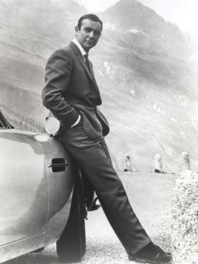 Sean Connery Leaning on Car in Formal Outfit by Movie Star News
