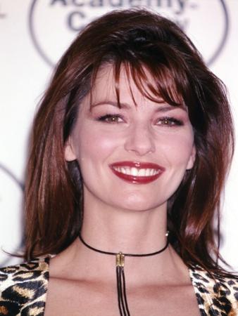 Shania Twain smiling in Animal Print Dress by Movie Star News