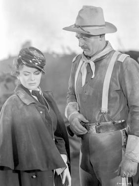 She Wore A Yellow Ribbon Man with Hat and Woman Talking by Movie Star News