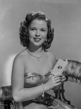 Shirley Temple Posed in Floral Dress by Movie Star News