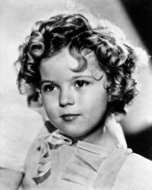 Shirley Temple wearing a Cap-Sleeve White Dress in Close Up Portrait by Movie Star News