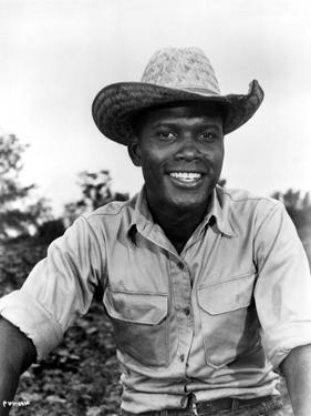 Sidney Poitier Posed in White Shirt With Hat by Movie Star News
