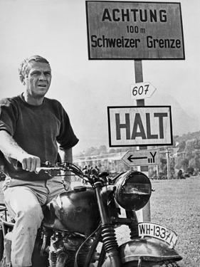 Steve McQueen in a Scene from the Great Escape on Motorcycle by Movie Star News