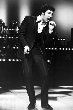 Tom Jones Posed in Black Suit With Microphone by Movie Star News