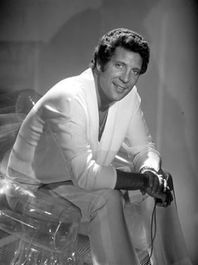 Tom Jones sitting in White Suit by Movie Star News