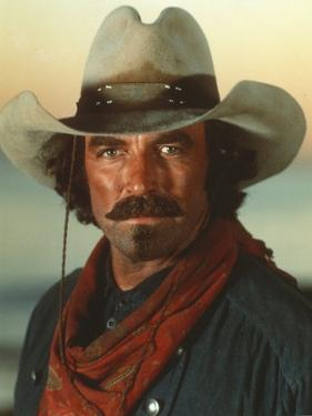 Tom Selleck wearing Green Sleeves with Red Scarf with Hat by Movie Star News