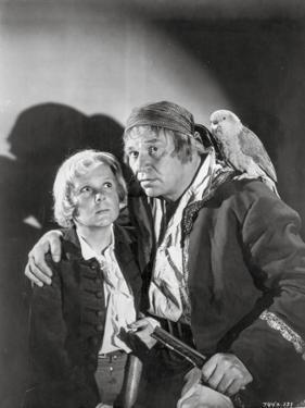 Treasure Island Movie Scene in Black and White with a Parrot by Movie Star News
