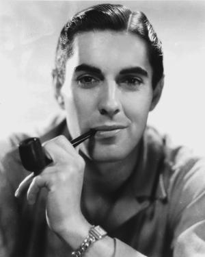 Tyrone  Powers smiling in Close Up Portrait wearing Yellow Winter Coat by Movie Star News