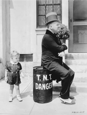W C Fields Man sitting on in Danger Can by Movie Star News