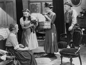 Wizard Of Oz Three People Listening at Old Woman Talking in Black and White by Movie Star News