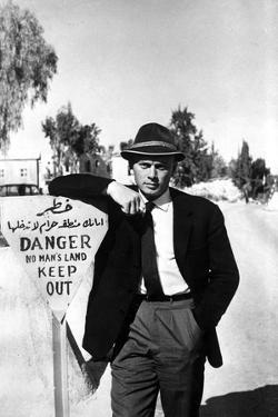 Yul Brynner Leaning in Sign Board With Hat by Movie Star News