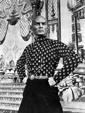 Yul Brynner standing in polka dot With Hands on Hip by Movie Star News