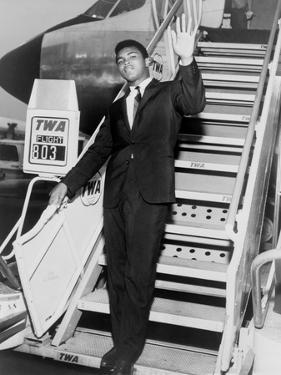 Muhammad Ali, Waves from the Steps of a TWA Airplane at JFK Airport, NYC, 1964