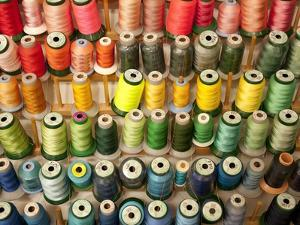 Multi-colored thread in high school sewing class