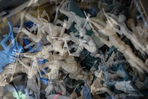 Multiple exposures of toy army men