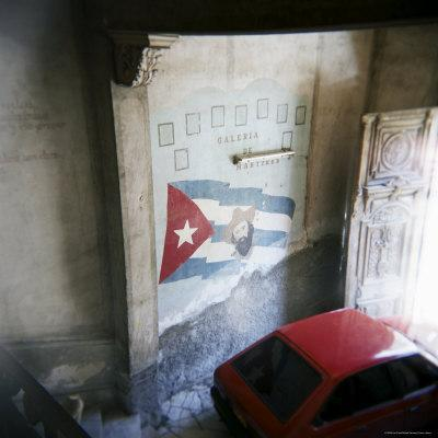 https://imgc.allpostersimages.com/img/posters/mural-of-camilo-cienfuegos-on-the-wall-of-an-apartment-building-havana-cuba_u-L-P2QSW30.jpg?p=0