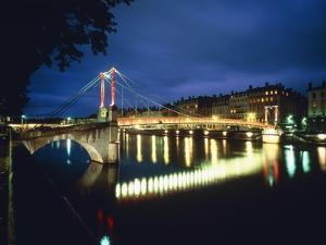 St. Georges Bridge over River Saône at Night, France by Murat Taner