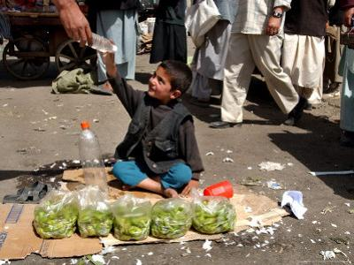 Afghan Child 5, Receives a Bottle of Water by Musadeq Sadeq