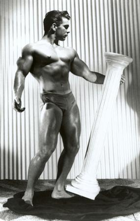 Muscle Man Dancing with Pillar
