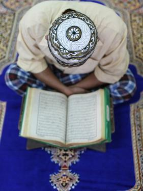 Muslim Man Reading the Quran in Mosque, Ho Chi Minh City, Vietnam, Indochina, Southeast Asia, Asia